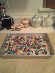 """My son made me a """"Celebration Candy Cake"""" -- complete with M&Ms, Milk Duds, and Reese's Pieces on top -- a chocolate lover's fantasy dessert."""